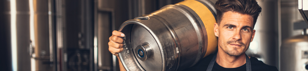 Man holding a beer keg